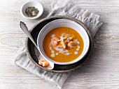 Thai pumpkin soup with coconut and prawns