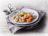 Prawns in a coconut coating with a pineapple and cucumber salad