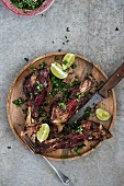 Roasted lamb shanks with peas, mint and lime