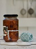 Pear chutney with cranberries in a glass jar