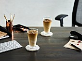 Iced coffee on a desk in an office