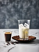 Milk with ice cubes and espresso