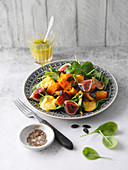 Pumpkin salad with baby spinach, figs and a turmeric dressing