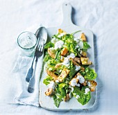 Lettuce with chicken, chive dressing and cheese and garlic croutons