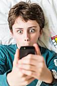 Teenage boy using a Smartphone