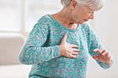 Woman suffering from a mild heart attack