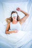 Woman wearing eye shades sleep mask