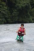 Teenager waterskiing