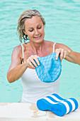 Woman in a pool wearing a bathing cap