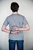 Teenager crossing his fingers