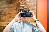 Teenager wearing a virtual reality headset