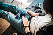 Teenager playing videogames