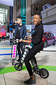 Foldable electric scooters at a car show, USA