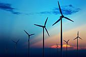 Wind farm against blue sky