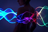 Woman with multicoloured lights on body