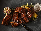 BBQ spare ribs with coleslaw, corn on the cob and beer