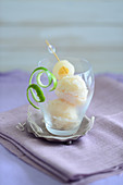 Lychee ice cream in a glass with lime peel