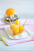 Mango shots with orange juice