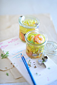 Prawn soup with saffron and fennel in jars