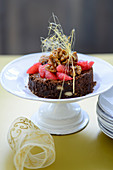 Chocolate cake with pink grapefruit and caramelised walnuts