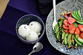 Avocado and strawberry salad with pine nuts, and a bowl of ice cream