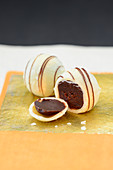 White truffle pralines with fine chocolate stripes