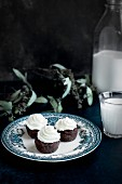 Brownie Bites with Orange Blossom Mascarpone Frosting served with milk