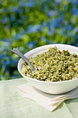 A bowl of rice with green pesto