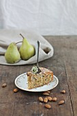 A slice of pear and almond cake with a fork