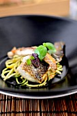 Fried sea bass with zoodles