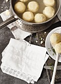 Potato dumplings cooking in a pan