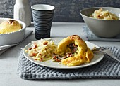 Potato dumplings filled with bacon served with a bacon and cabbage salad