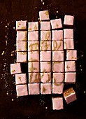 Gingerbread squares with pink icing and golden lettering
