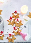 Gingerbread stars decorated as Father Christmas