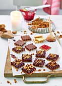 Chocolate brittle biscuits with raspberry jam