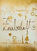 Abdrücke von Weihnachtsmotiven in Puderzucker und Schokoladenschrift auf Golduntergrund