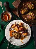 Venison steaks with a cashew nuts crust and clementine jus