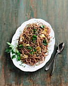 Wholemeal spaghetti with beluga lentils and fried oyster mushrooms