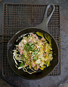 Scrambled eggs with ham, pointed cabbage and parsley