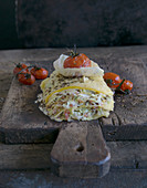 Pointed cabbage lasagne with bacon, caraway and oven-baked tomatoes