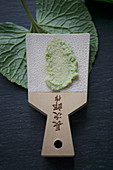 Grated wasabi on a wasabi grater made from shark skin