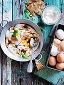 Fried eggs and spiced yoghurt sauce