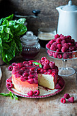 Cheesecake with raspberries in jelly, sliced