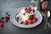 Gluten-free banana pancakes with raspberries and blueberries