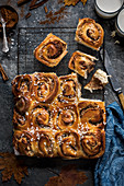Apple and cinnamon buns, view from above with milk