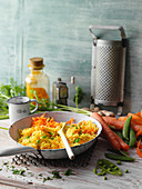 Fried turmeric rice with peas and carrot