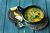 Indian lentil soup with spinach and turmeric