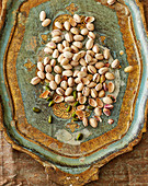 Pistachios on an oriental wooden tray