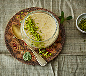 Harireh Badum – Persian almond rice pudding with pistachios