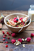 Granola with figs, berries and pomegranate seeds